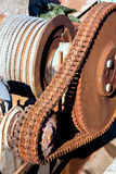 Chain transmission. Rusty chain transmission consist of one big and a small cogwheel and large strong chain Royalty Free Stock Image