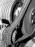 Chain transmission. A photo of chain transmission consist of one big and a small cogwheel and large chain Royalty Free Stock Photography