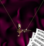 Chain with treble clef and notes Stock Photos