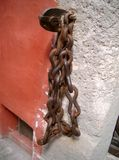 Chain on the wall. Solid metal chain on the wall stock photo