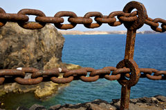 Chain  water  boat yacht coastline and summer in lanzarote spain Royalty Free Stock Photos