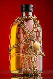 Chain and whisky bottle Royalty Free Stock Image