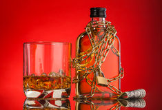 Chain and whisky bottle Royalty Free Stock Photo