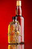 Chain and whisky bottles Royalty Free Stock Images
