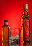 Chain and whisky bottles Stock Images