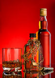 Chain and whisky bottles Royalty Free Stock Photo