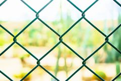 Chain wire wall link,for security. Rusty steel chain link wall for background,closeup Royalty Free Stock Photo