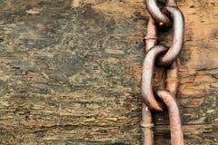 Chain on Wood Stock Photo
