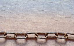 Chain on wood Stock Photos