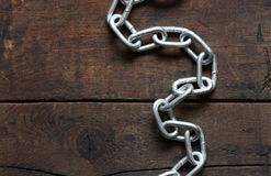 Chain On Wood Stock Images