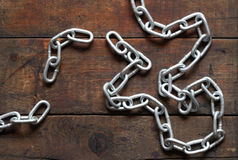 Chain On Wood Stock Image