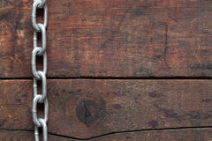Chain On Wood Royalty Free Stock Images