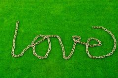 Chain writes love Stock Photos
