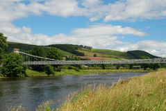 Chainbridge over river Tweed at Melrose, Scotland. Chain bridge across river Tweed at Melrose built 1826 Royalty Free Stock Photography