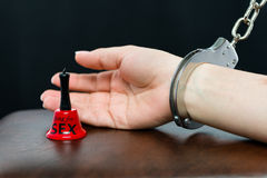 Chained arm with ring for sex bell in front Stock Photos