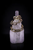 Chained bottle of vodka. In ice cube, isolated on black royalty free stock images