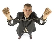 Chained businessman. Businessman with chains on his hands Royalty Free Stock Photos