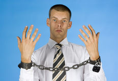 Chained businessman Stock Photo