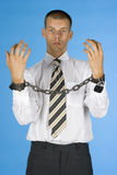 Chained businessman. Businessman with chains on his hands Royalty Free Stock Photo