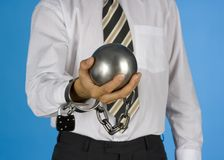 Chained businessman. Businessman with ball and chain Royalty Free Stock Images