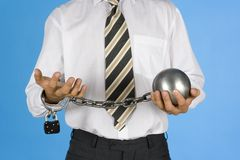 Chained businessman. Businessman with chains on his hands Stock Photo