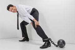 Chained businessman. Full length of hopeless businessman trying Stock Photography