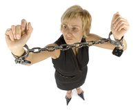 Chained businesswoman. Businesswoman with chains on her hands Stock Photos