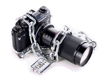 Chained Camera. Camera with a chain and lock Royalty Free Stock Images