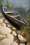 Chained drowned rowing boat Royalty Free Stock Image
