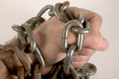 Chained fist. Fist with chain Royalty Free Stock Images