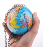 Chained globe Stock Photo