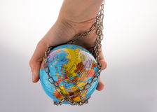 Chained globe Stock Images