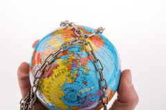 Chained globe Royalty Free Stock Images