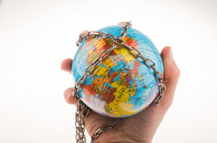 Chained globe. Globe in chain on a white background Stock Photo