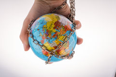 Chained globe. Globe in chain on a white background Royalty Free Stock Photography