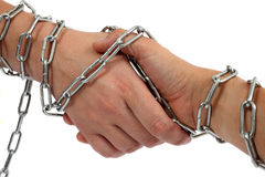Chained greeting. Greeting hands with chains around it. Commitment in friendship and business royalty free stock photo
