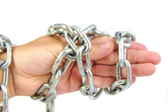 Chained hand of an adult man with strong chain Royalty Free Stock Images