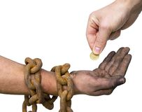 Chained hand and coin Stock Images