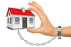 Chained hand holding house Stock Images