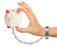 Chained hand holding piggy bank Royalty Free Stock Photo