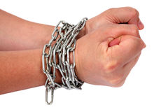 Chained hands. Hands in chains. Hands clenching trying to get free from chains royalty free stock photography