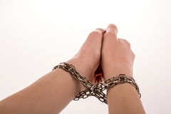 Chained hands. Hands in chains on a white background Stock Image