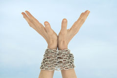 Chained hands and sky Royalty Free Stock Images