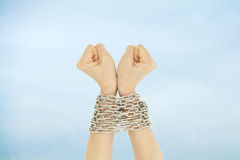 Chained hands and sky Royalty Free Stock Image