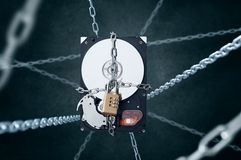 Chained hard disc drive with combination padlock. Conception of data security Stock Photos