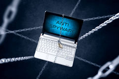 Chained laptop with anti spam symbol Royalty Free Stock Images