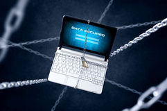 Chained laptop with login panel. Stock Photo
