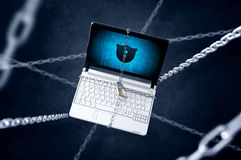 Chained laptop with shield symbol. Royalty Free Stock Images