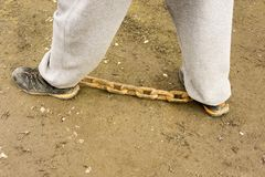 Chained legs. With rusty chain Stock Photography