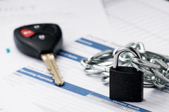 Chained lock signing a contract when you buy a car document is mock-up Stock Images